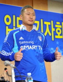 North Korean football striker Jong TaeSe poses in his Suwon Samsung Bluewing uniform during a press conference for his transfer in Seoul on January...
