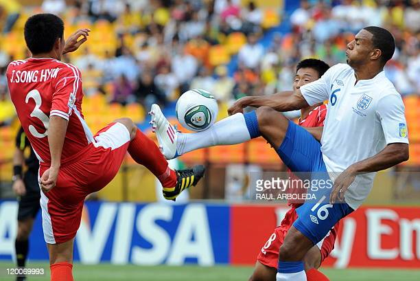 North Korean footballer Jang Song Hyok vies for the ball with England Matthew Phillips during the U20 World Cup Group F first round football match...
