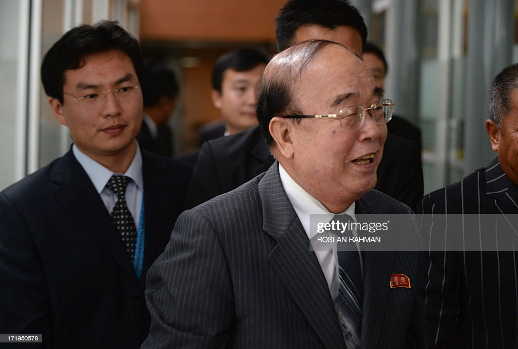 North Korean Foreign Minister Pak Ui-Chun (front C) smiles as he arrives at the annual 10-member Association of Southeast Asian Nations (ASEAN) foreign ministers' meeting in Brunei's capital Bandar Seri Begawan on June 30, 2013. Southeast Asia's top diplomats kicked off a major regional forum on June 30 with a firm focus on trying to ease tensions with China over a territorial row, amid warnings that failure could lead to conflict. AFP PHOTO / ROSLAN RAHMAN
