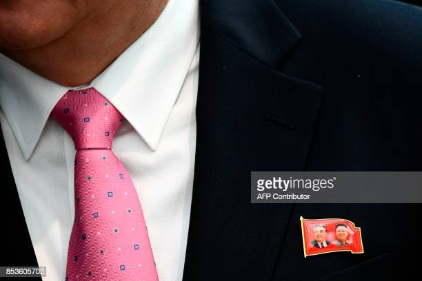 North Korean Foreign Minister Ri Yongho wearing a pin with images of North Korean leader Kim JongUn and his late father Kim Kim Jongil speaks to...