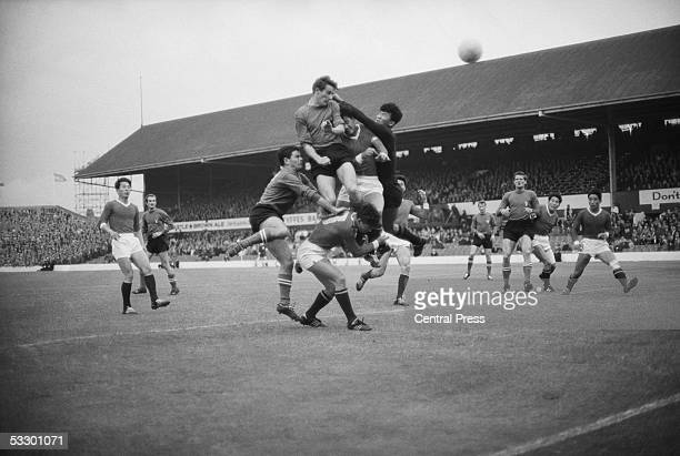 North Korean goalkeeper Li Chan Myung clears while Romano Fogli and Marino Perani of Italy with North Korea's Oh Yoon Kyung all go up for the ball at...