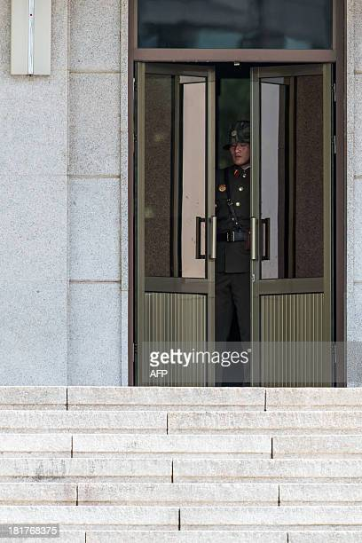 A North Korean guard closes a door of the PanmunGak building in the truce village of Panmunjom in the Demilitarized zone dividing the two Koreas on...