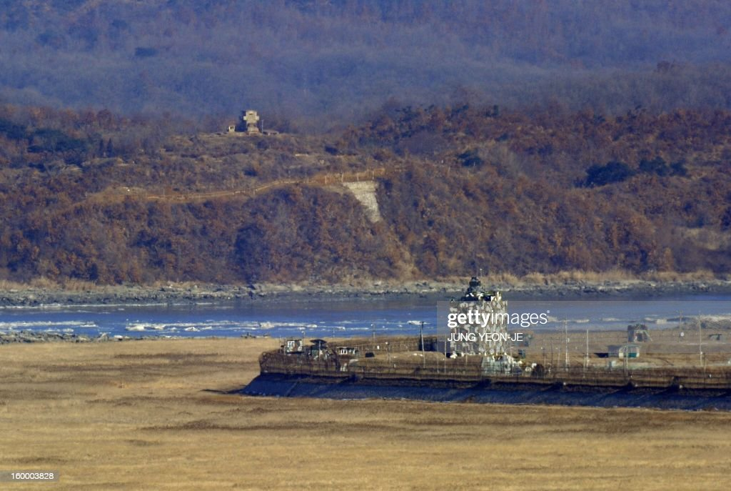 A North Korean guard post (top) and a South Korean guard post (centre R) stand opposite each other as seen from a South Korean observation post in Paju near the Demilitarized Zone (DMZ) dividing the two Koreas on January 25, 2013. North Korea on January 25 threatened 'physical counter-measures' against rival South Korea the latest in a series of bellicose warnings sparked by a tightening of UN sanctions against Pyongyang.