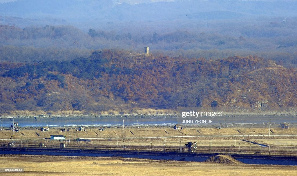 A North Korean guard post (top) and South Korean guard post (bottom) stand opposite each other as seen from a South Korean observation post in Paju near the Demilitarized Zone (DMZ) dividing the two Koreas on January 25, 2013. North Korea on January 25 threatened 'physical counter-measures' against rival South Korea, the latest in a series of bellicose warnings sparked by a tightening of UN sanctions against Pyongyang.