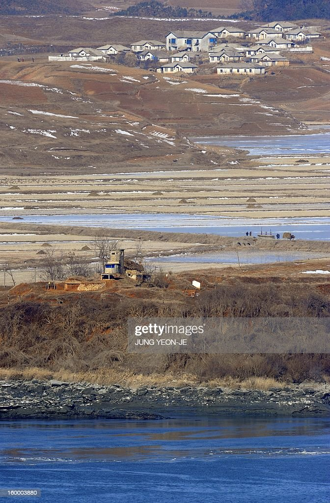 A North Korean guard post (bottom) in the border county of Kaepoong is seen from a South Korean observation post in Paju near the Demilitarized Zone (DMZ) dividing the two Koreas on January 25, 2013. North Korea on January 25 threatened 'physical counter-measures' against rival South Korea, the latest in a series of bellicose warnings sparked by a tightening of UN sanctions against Pyongyang.