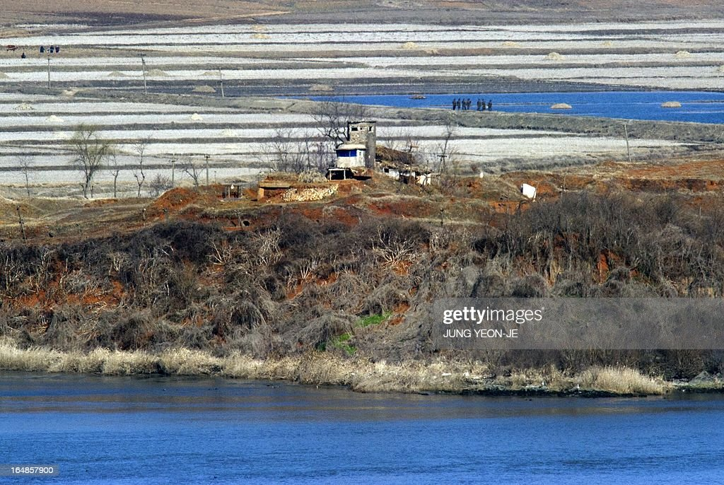 A North Korean guard post in the border county of Kaepoong is seen from a South Korean observation post in Paju near the Demilitarized Zone (DMZ) dividing the two Koreas on March 29, 2013. North Korean leader Kim Jong-Un ordered preparations on March 29, for strategic rocket strikes on the US mainland and military bases after US stealth bombers flew training runs over South Korea. AFP PHOTO / JUNG YEON-JE