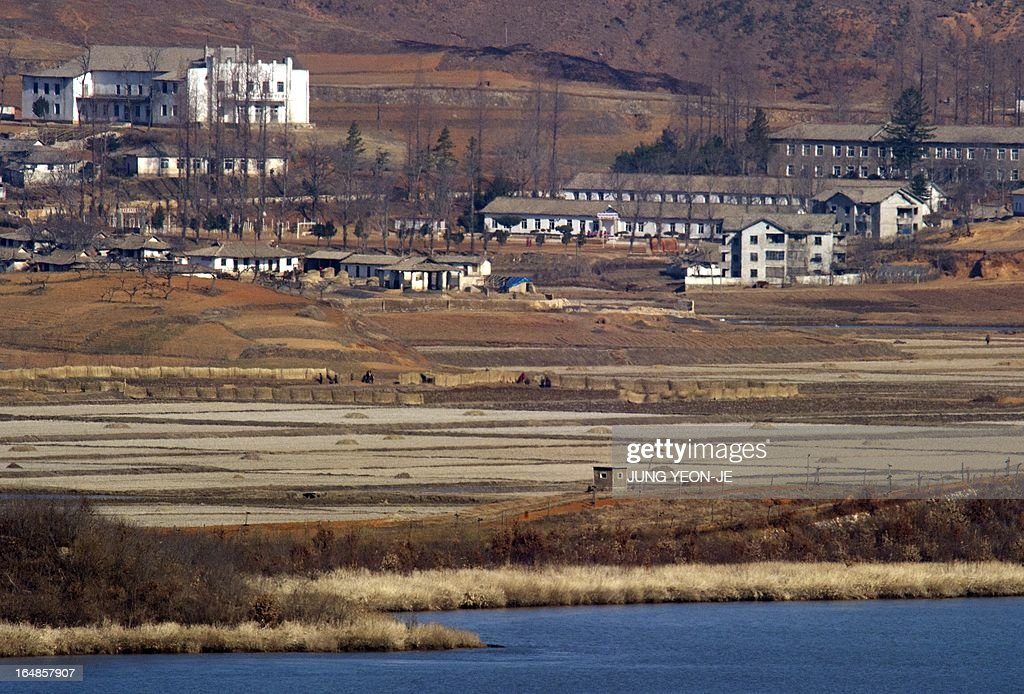 A North Korean guard post (bottom) in the border county of Kaepoong is seen from a South Korean observation post in Paju near the Demilitarized Zone (DMZ) dividing the two Koreas on March 29, 2013. North Korean leader Kim Jong-Un ordered preparations on March 29, for strategic rocket strikes on the US mainland and military bases after US stealth bombers flew training runs over South Korea. AFP PHOTO / JUNG YEON-JE
