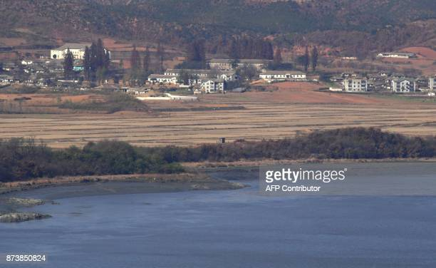 A North Korean guard post in the border county of Kaepoong is seen from a South Korean observation post in Paju near the Demilitarized Zone dividing...