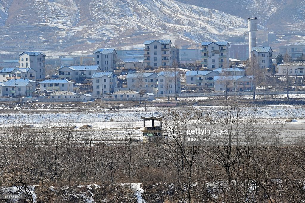 A North Korean guard post (C) in the propaganda village of Gijeongdong is seen from South Korea's Taesungdong freedom village near the border village of Panmunjom during a graduation ceremony for Taesungdong Elementary School in Paju on February 15, 2013. Six students graduated from the only school in this South Korean village sitting inside the demilitarized zone between North and South Korea where a total of 30 students study under a heavy military presence.