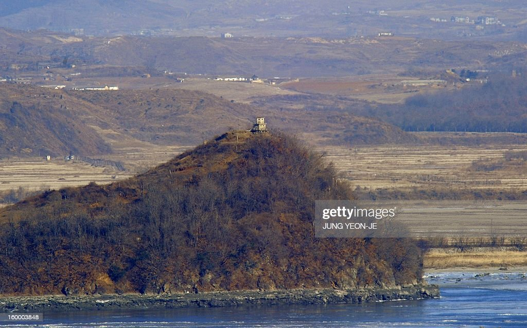 A North Korean guard post on the top of a hill is seen from a South Korean observation post in Paju near the Demilitarized Zone (DMZ) dividing the two Koreas on January 25, 2013. North Korea on January 25 threatened 'physical counter-measures' against rival South Korea, the latest in a series of bellicose warnings sparked by a tightening of UN sanctions against Pyongyang.