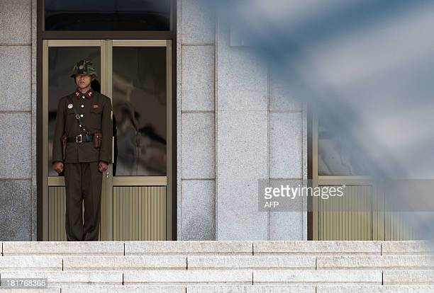 A North Korean guard stands in front of the PanmunGak building in the truce village of Panmunjom in the Demilitarized zone dividing the two Koreas on...