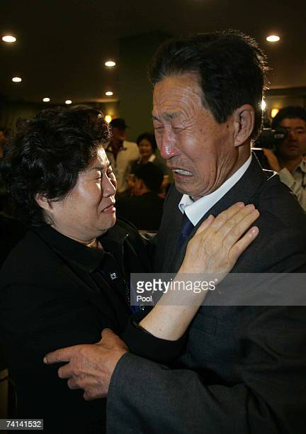 North Korean Kim BongHwan 77 and and his South Korean younger sister Kim BongSook bid each other farewell after their threeday temporary family...