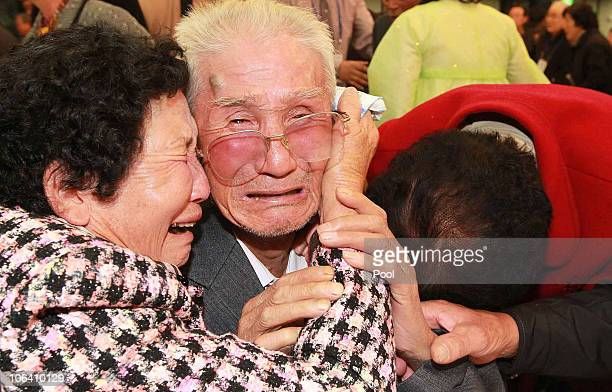 North Korean Kim JinWon bids farewell to his South Korean relatives after a family reunion after being separated for 60 years following the North...