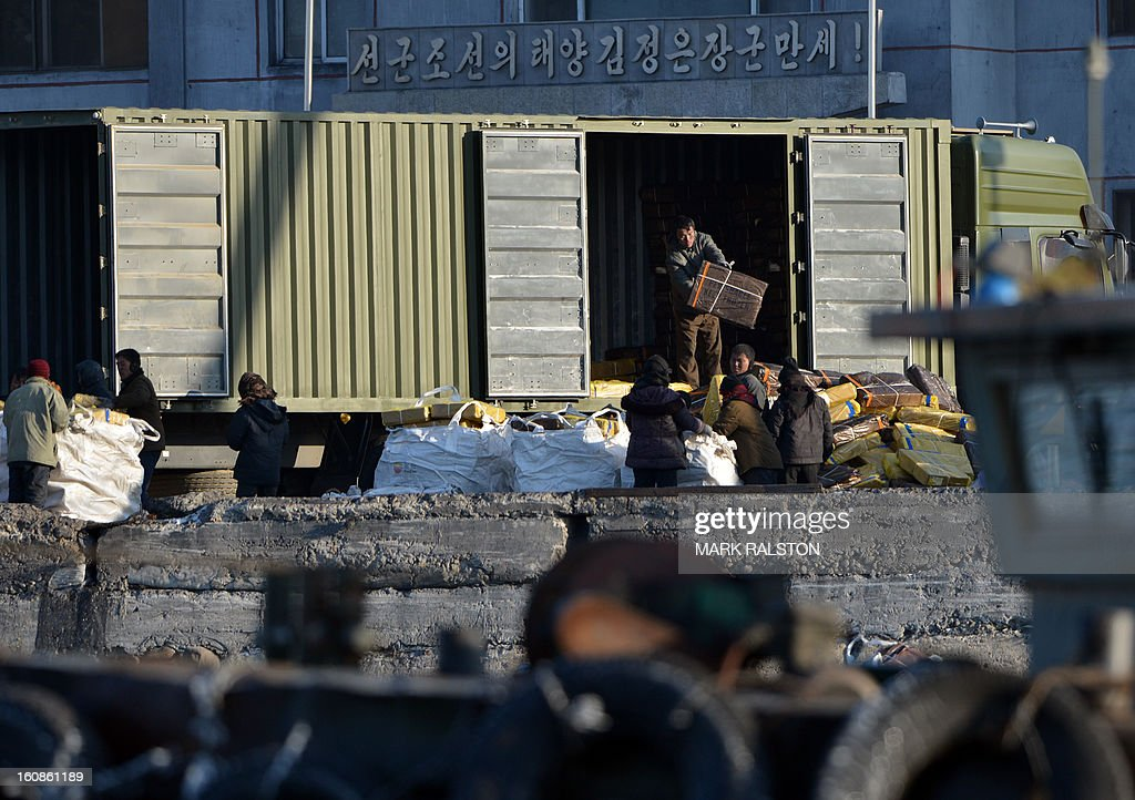 North Korean laborers unload a truck on the banks of the Yalu River near the town of Sinuiju on February 7, 2013 across from the Chinese city of Dandong. North Korea has vowed to carry out a third nuclear test, but scientists and concerned foreign governments may have a tough time verifying the actions of the reclusive state. AFP PHOTO/Mark RALSTON