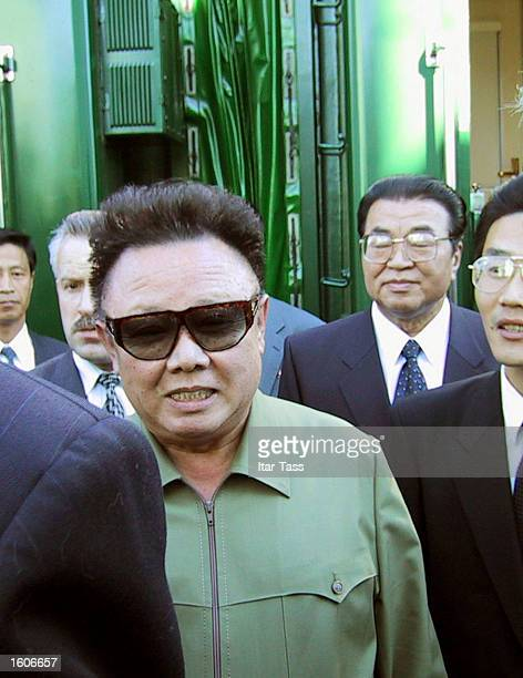 North Korean leader Kim Jong Il center arrives August 1 2001 at the train station in the Siberian city of Omsk Russia for the first stopover on his...