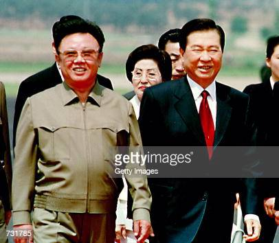 North Korean leader Kim Jong Il left and South Korean President Kim Daejung right meet to reconcile political differences as Kim Daejung arrives June...