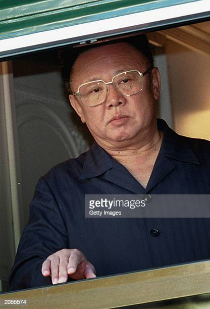 North Korean leader Kim Jong Il looks out of a window from his armored train at a Russian border railway station in Khasan Far East Russia August 20...