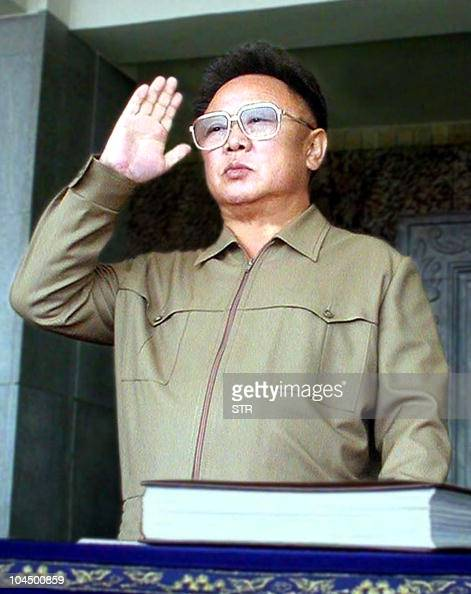 North Korean leader Kim Jong Il salutes to his troops from the podium during a military parade in Pyongyang 25 April 2002 to mark the 70th...