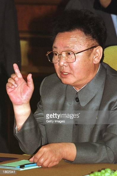 North Korean leader Kim Jongil gestures during second round talks with South Korean President Kim Daejung June 14 2000 at Baekhwawon State Guest...