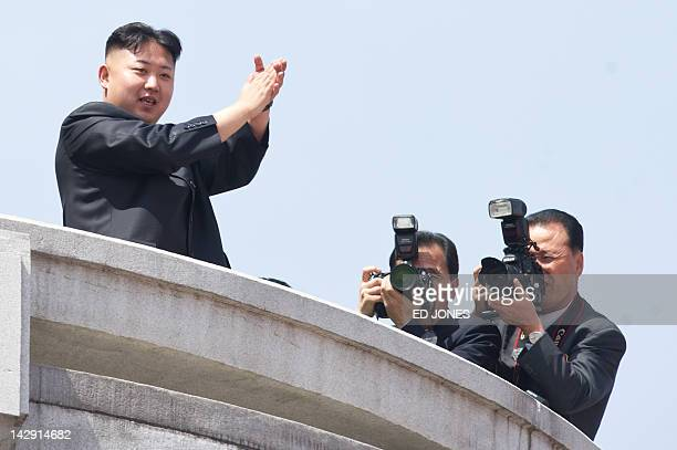 North Korean leader Kim JongUn applauds during a military parade in honour of the 100th birthday of the late North Korean leader Kim IlSung in...