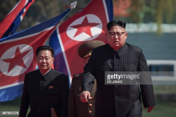 North Korean leader Kim JongUn arrives flanked by vicechairman of the State Affairs Commission Choe YongHae at an opening ceremony for 'Rymoyong...