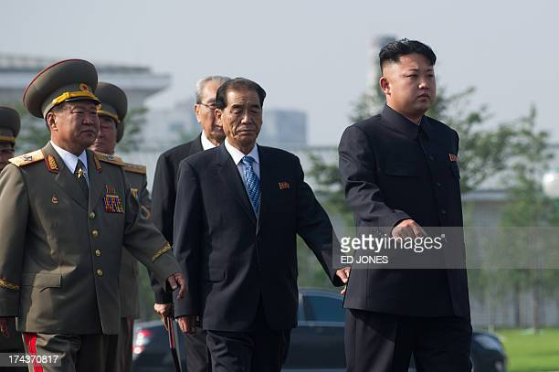 North Korean leader Kim JongUn arrives to attend the inauguration of a Korean war military cemetery in Pyongyang on July 25 2013 Selected remains of...