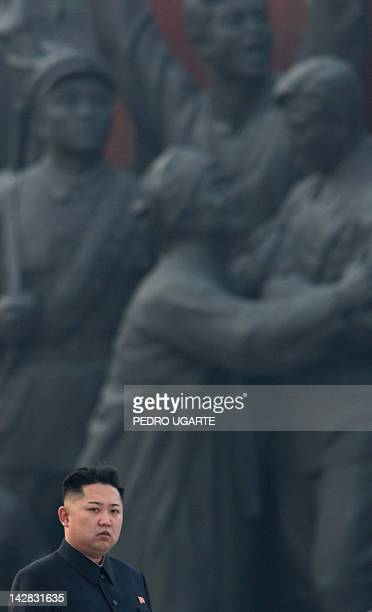 North Korean leader Kim JongUn attends the unveiling of two statues of former leaders Kim IlSung and Kim JongIl in Pyongyang on April 13 2012 North...