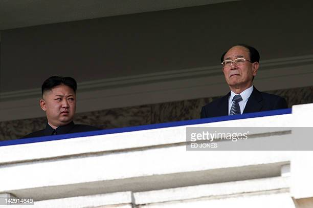 North Korean leader Kim JongUn looks at President of the Presidium of the Supreme People's Assembly of North Korea Kim Yongnam during a military...