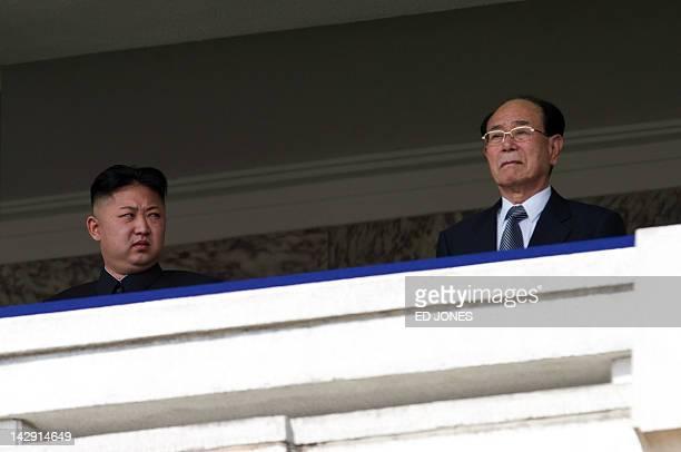 North Korean leader Kim JongUn looks at President of the Presidium of the Supreme People's Assembly of North Korea Kim Yongnam during a military...