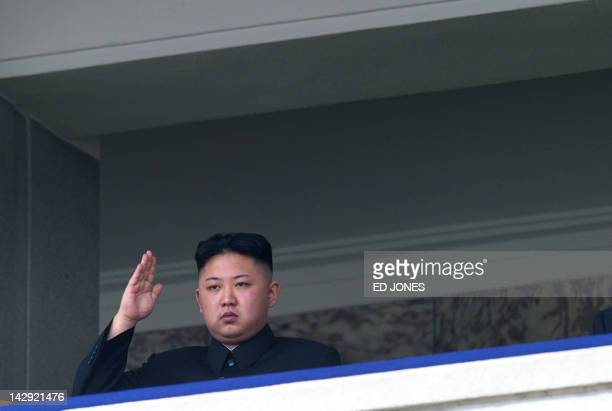 North Korean leader Kim JongUn salutes as he watches a military parade to mark 100 years since the birth of the country's founder and his grandfather...