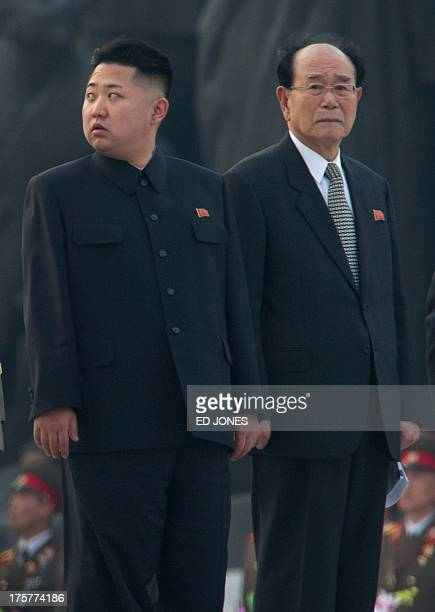 North Korean leader Kim JongUn stands with Chairman of the Supreme People's Assembly Kim YongNam as he attends the unveiling ceremony of two statues...