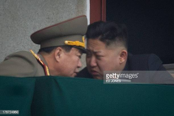 North Korean leader Kim JongUn talks to a military aide during an official ceremony at the Kim IlSung stadium in Pyongyang on April 14 2012 North...