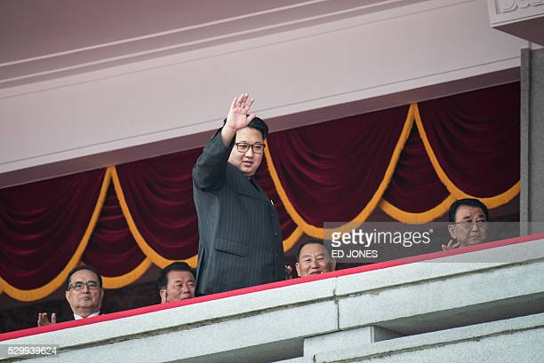 TOPSHOT North Korean leader Kim JongUn waves as he walks past topranking party officials from a balcony of the Grand People's Study House following a...
