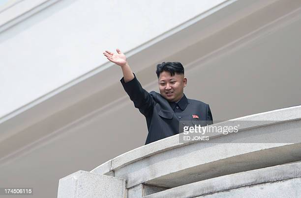 North Korean leader Kim JongUn waves to the crowd during a military parade at Kim IlSung square marking the 60th anniversary of the Korean war...
