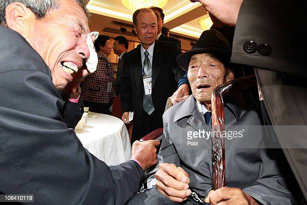 North Korean Lee JongYeol aged 90 bids farewell to his South Korean son Lee MinKwan after a family reunion after having been separated for 60 years...