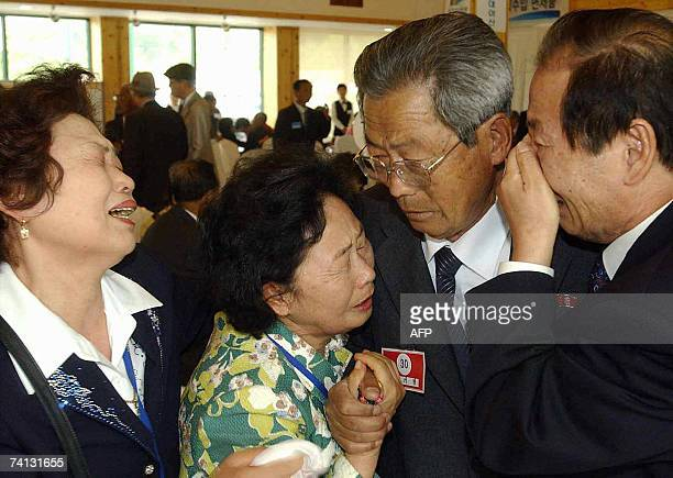 North Korean Lee KiYoung weeps with his South Korean family members during their family reunion meeting at a resort in Mount Kumgang 12 May 2007...
