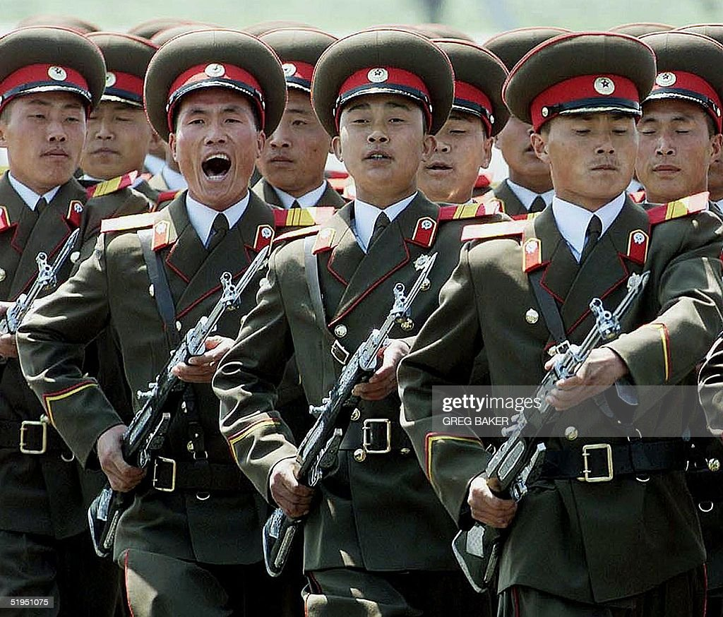 A North Korean military honor guard marches past during a welcome ceremony for European Council President and Swedish Prime Minister Goran Persson at Pyongyang airport, 02 May 2001.  Persson is leading a European Union delegation on a three-day visit to North Korea for talks aimed at helping the ailing peace process for the Korean peninsula.  (Photo credit should read GREG BAKER/AFP/Getty Images)