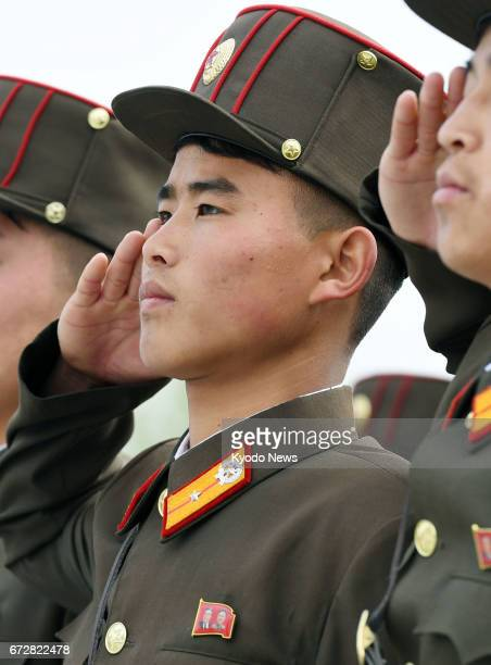 North Korean military personnel salute toward the statues of Kim Il Sung and Kim Jong Il at Mansudae Hill in Pyongyang on April 25 the 85th...