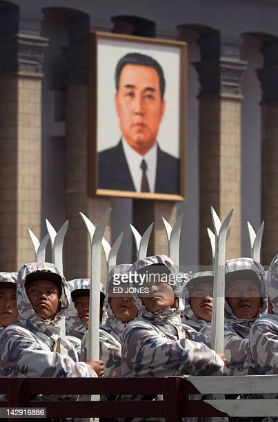North Korean military ride past a portrait of former leader Kim IlSung during a military parade to mark 100 years since the birth of the country's...