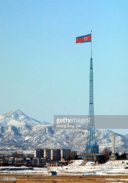 North Korean national flag is seen January 29 2003 above the village of Gijungdong in the northern section of the Demilitarized Zone South Korean...