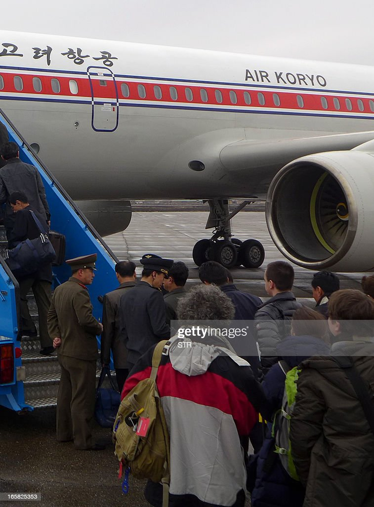 North Korean officials check the passports of a group of foreign diplomats and tourists as they board an Air Koryo flight to Beijing at the airport in Pyongyang, North Korea on April 6, 2013. Foreign diplomats in North Korea appeared to be staying put, ignoring a warning by Pyongyang that they should consider evacuating their missions amid soaring nuclear tensions, as Pyongyang had informed embassies it could not guarantee their safety if a conflict broke out as concerns grew that the isolated state was preparing a missile launch.