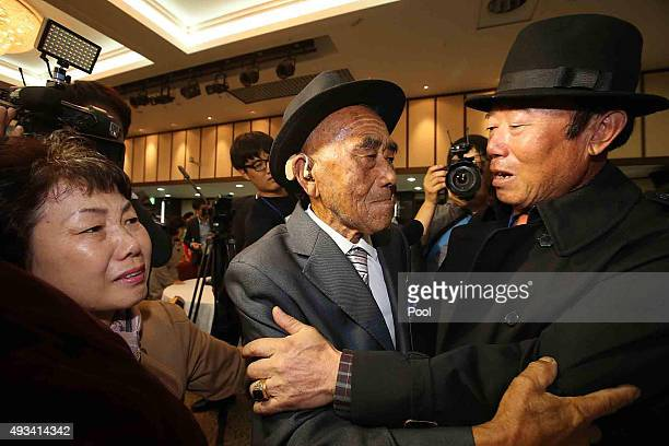 North Korean Oh InSe meets with his South Korean son Oh Jangkyun during the family reunion after being separated for 60 years on October 20 2015 in...