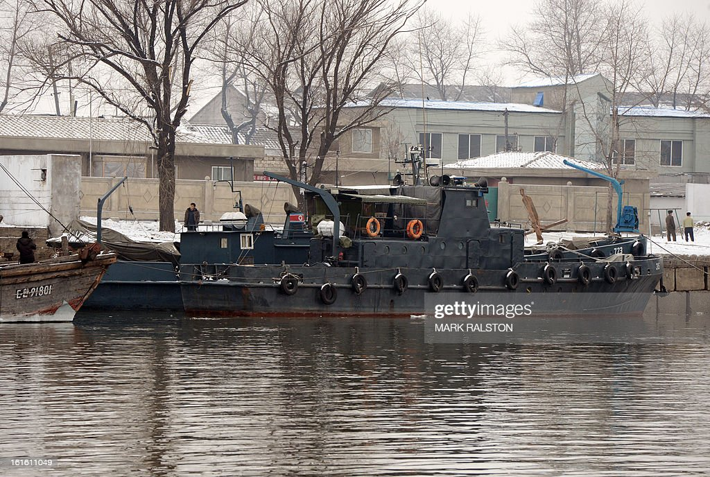 A North Korean patrol boat is docked on the banks of the Yalu River at the North Korean town of Sinuiju across from the Chinese city of Dandong on February 13, 2013. While the rest of the world reacted with outrage, North Koreans were swept up in a 'storm of excitement' over their country's latest nuclear test, state media reported. The countries third nuclear test was widely condemned by the international community, led by the United States and the UN Security Council, which met in emergency session the same day. AFP PHOTO/Mark RALSTON