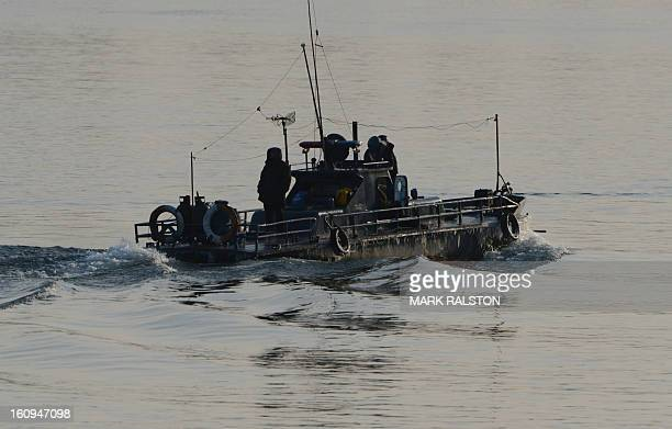 A North Korean patrol boat motors on the Yalu River near the North Korean town of Sinuiju on February 8 2013 which is close to the Chinese city of...