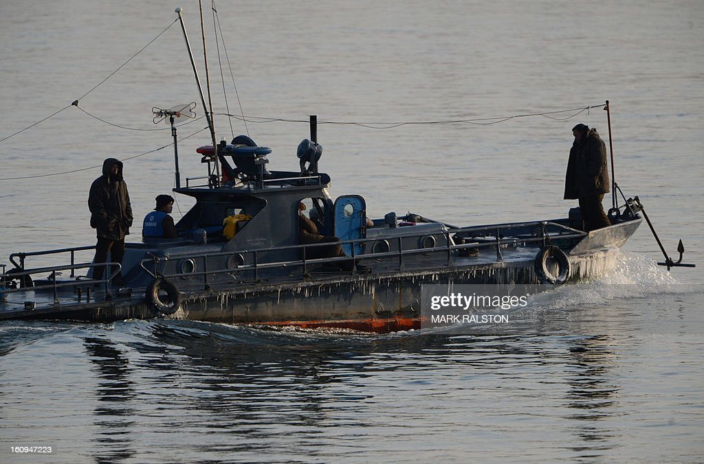 A North Korean patrol boat motors on the Yalu River near the North Korean town of Sinuiju on February 8, 2013 which is close to the Chinese city of Dandong. US Secretary of State John Kerry warned that North Korea's expected nuclear tests only increase the risk of conflict and would do nothing to help the country's stricken people. The country has vowed to carry out a third nuclear test soon, and concerns have been raised over the type of fissile material used in the device. AFP PHOTO/Mark RALSTON