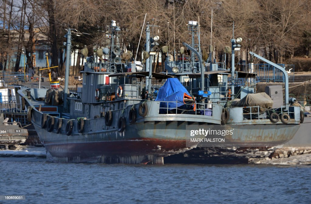 North Korean patrol boats sit docked during low tide on the Yalu River near the town of Sinuiju on February 7, 2013 across from the Chinese city of Dandong. North Korea has vowed to carry out a third nuclear test, but scientists and concerned foreign governments may have a tough time verifying the actions of the reclusive state. AFP PHOTO/Mark RALSTON