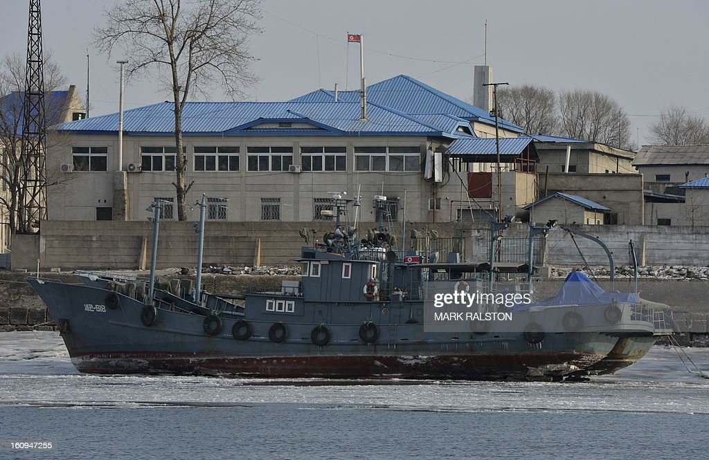 North Korean patrol boats sit on an iced Yalu River near the North Korean town of Sinuiju on February 8, 2013 which is close to the Chinese city of Dandong. US Secretary of State John Kerry warned that North Korea's expected nuclear tests only increase the risk of conflict and would do nothing to help the country's stricken people. The country has vowed to carry out a third nuclear test soon, and concerns have been raised over the type of fissile material used in the device. AFP PHOTO/Mark RALSTON