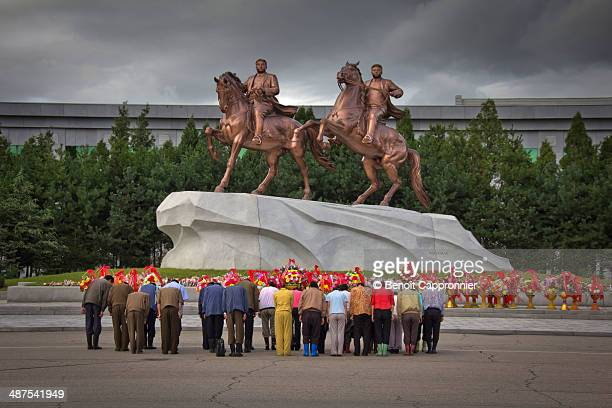 North korean paying their respect to the statues o