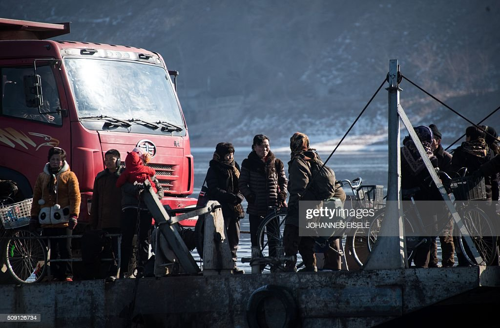North Korean people and a truck embark on a boat on the Yalu River near the town of Sinuiju across from the Chinese border town of Dandong on February 9, 2016. A raft of UN sanctions imposed on North Korea over the past decade has failed to prevent Pyongyang from scaling up its nuclear and ballistic missile programs, a UN panel of experts has concluded. AFP PHOTO / JOHANNES EISELE / AFP / JOHANNES EISELE