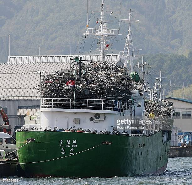 North Korean ship packs a cargo of used bicycles and refrigerators at the Maizuru port October 13 2006 in Maizuru Japan The Japanese government has...